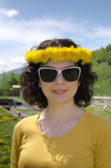 A young woman smiling wearing white sunglasses