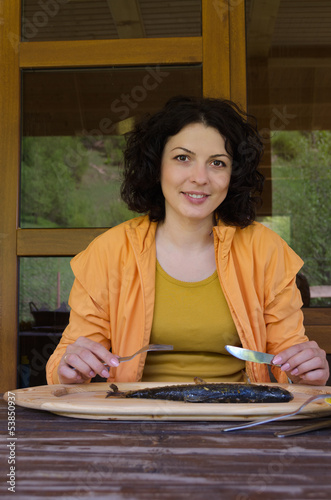 Woman enjoying a seafood meal