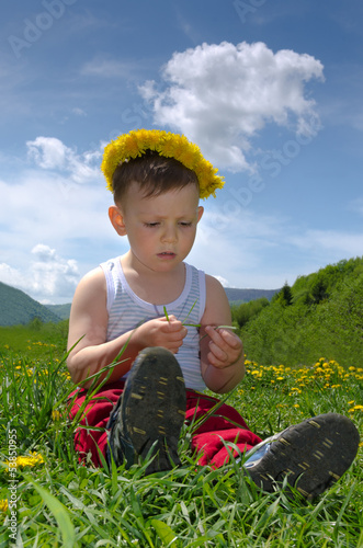 Little boy wearing a dandelion headband