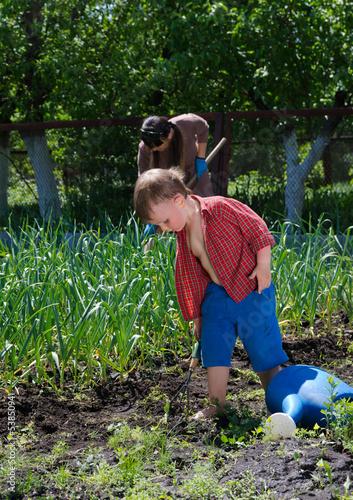 Little boy working in the garden