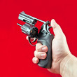 revolver in the man's hand