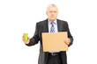 Bankrupted mature businessman holding a piece of cardboard and c