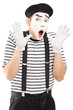 Male mime artist gesturing with his hands excitement