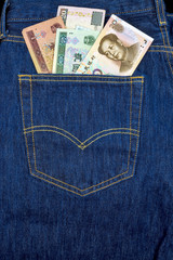 Chinese currency in the back pocket of new jeans