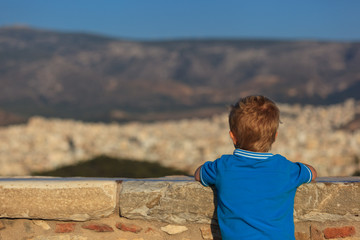 little boy looking at Athens, Greece
