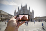Taking picture with smart phone in Milan