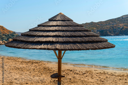 Staande foto Athene Unbrella on sand, in beach at greek island Syros in Cyclades