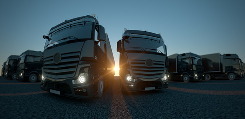 Panorama shot of trucks at sunset