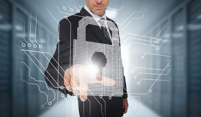Businessman selecting a futuristic padlock