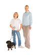 mother son standing and smiling with small dog isolated on white