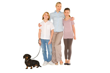 mother son daughter standing and smiling with small dog