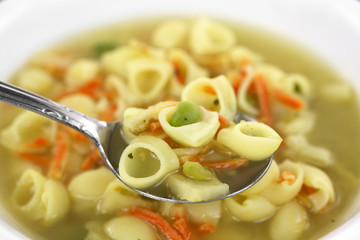 Spoonful of soup with pasta chicken broth base