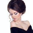Beautiful woman with make-up and hairstyle. Jewelry and Beauty.