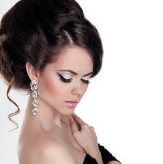 Fashion portrait of Beautiful woman with hairstyle and evening m