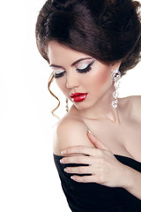 Beautiful woman with red lips, make-up. Jewelry and Beauty. Fash