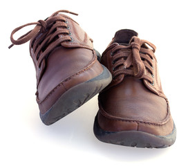 brown leather shoes isolated over white