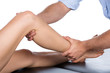 Physiotherapist massaging patient - 53865534