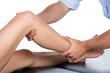 Leinwanddruck Bild - Physiotherapist massaging patient