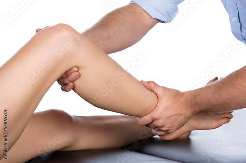 Leinwanddruck Bild Physiotherapist massaging patient