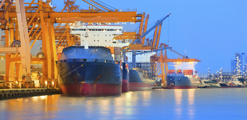 panorama scene of ship yard with heavy crane in beautiful twilig