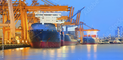 canvas print picture panorama scene of ship yard with heavy crane in beautiful twilig