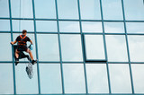 Industrial mountaineering workers wash windows