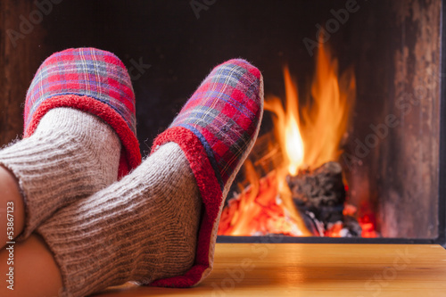 canvas print picture relaxing at the fireplace on winter evening