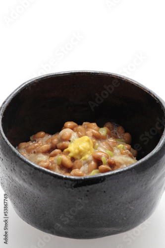 Natto, fermented soybeans on white background