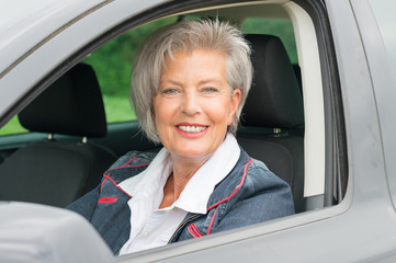 Senior woman in car