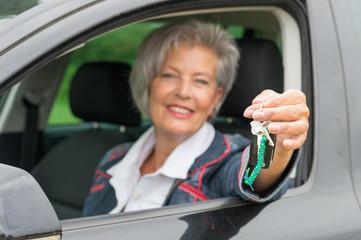 Senior woman in car
