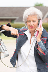 Senior woman at phone