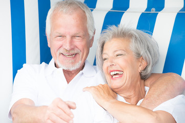 Senior couple in beach chair