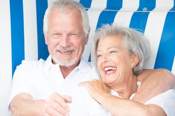 Senior couple in beach chair