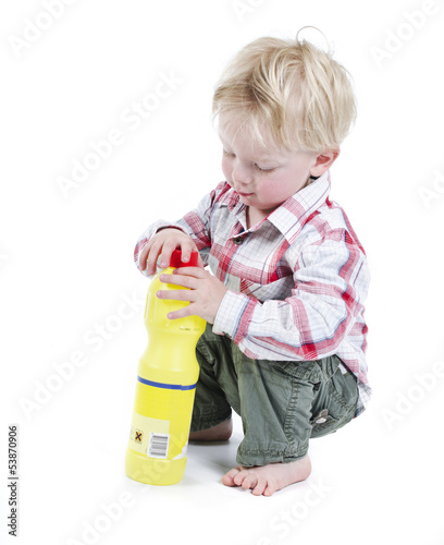 Infant playing with toxic bottle