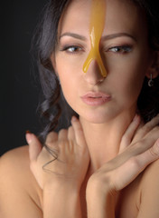 Beautiful woman with honey mask