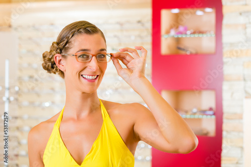 Young woman at optician with glasses