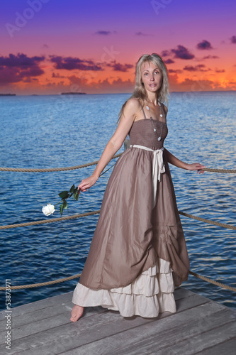 The beautiful woman on a wooden scaffold over the sea