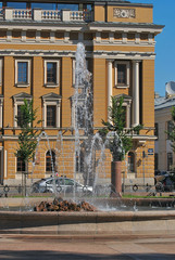 A fountain on the background of the building.