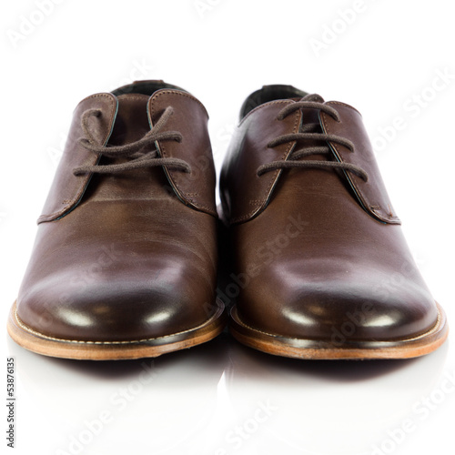 Brown man's shoes isolated on white background.  Pair of brown m