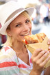 canvas print picture - Cheerful blond girl in Rome eating Focaccia sandwich