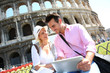 Couple in Rome using tablet to get tourist information