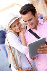 Tourists in Rome connected on internet with tablet