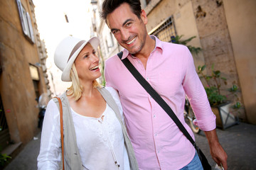 Cheerful couple walking on the streets of Rome