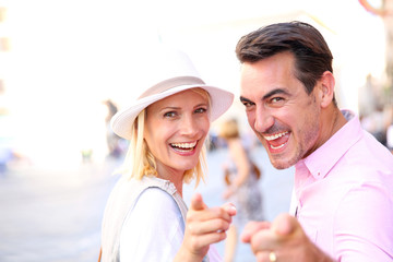 Cheerful couple visiting city of Rome