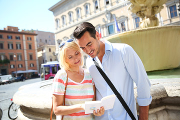 Couple of tourists in Farnese square of Rome