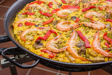 Detail of traditional spanish paella cooked in a pan