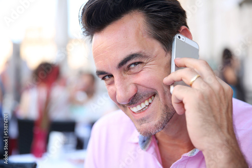Portrait of mature man using smartphone