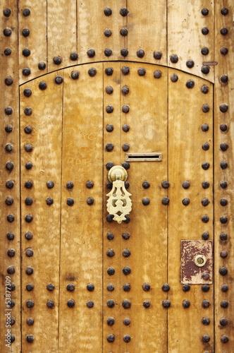 Wooden door with arab style doorknob