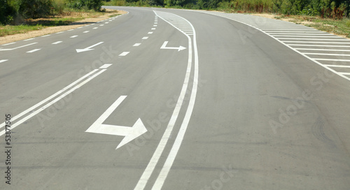 Arrow signs as road markings on suburban driveway