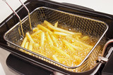 French fries in hot fat in a deep fryer